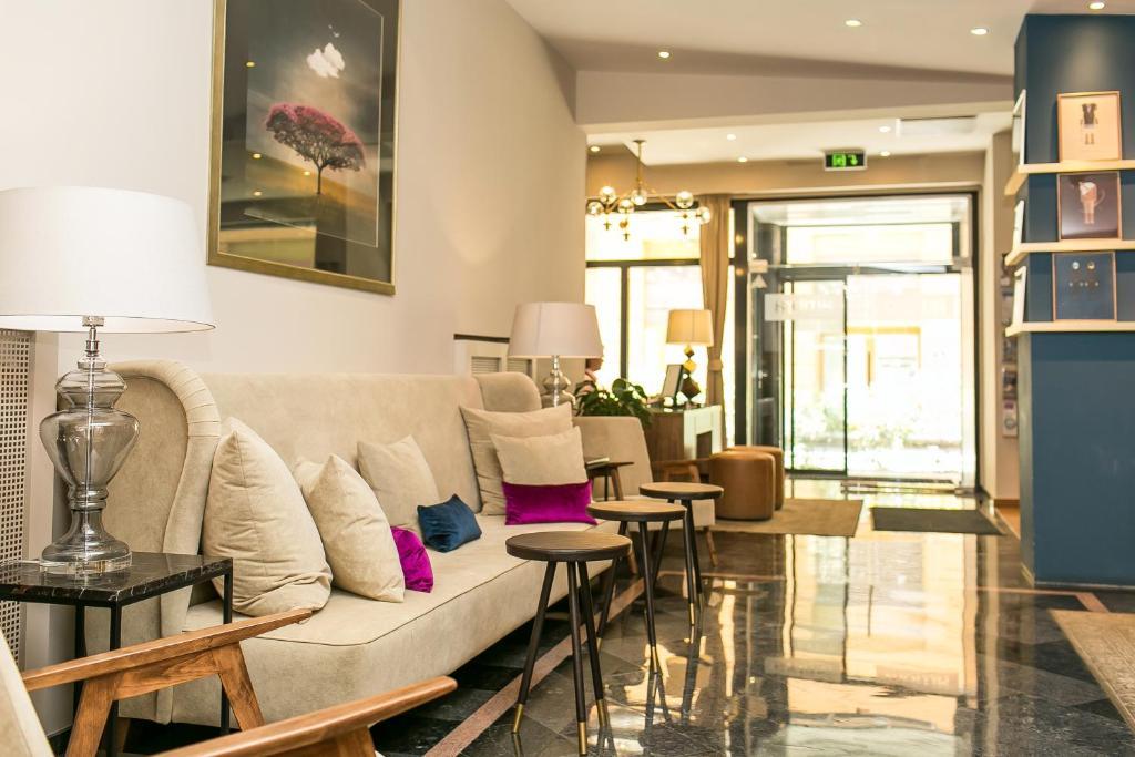 Coin salon dans l'établissement Ambra Hotel