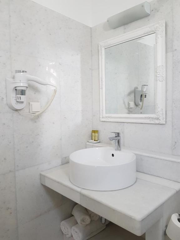A bathroom at Artemis Hotel