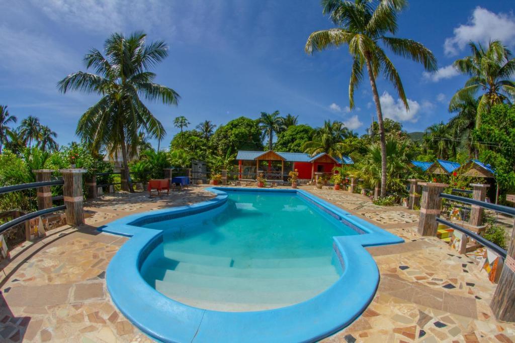The swimming pool at or near Rollanda Hotel