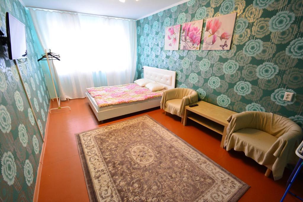 Кровать или кровати в номере Дзержинского 31