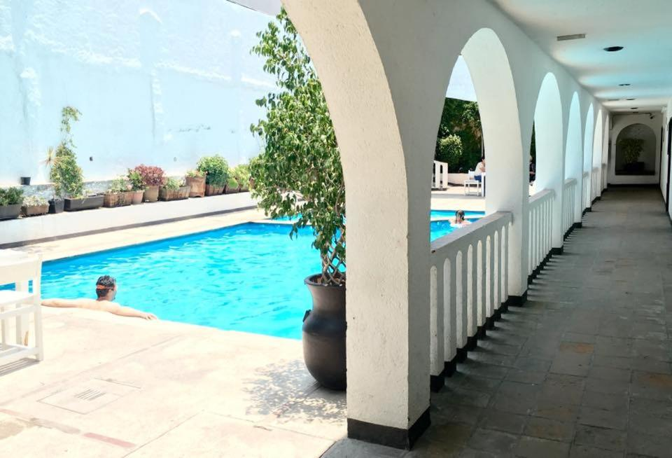The swimming pool at or near Hotel Calli Quetzalcoatl