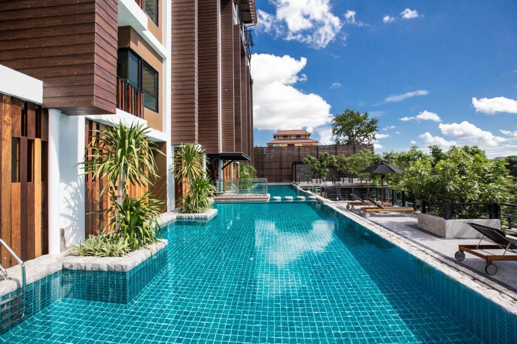 The swimming pool at or near Natee The Riverfront Hotel Kanchanaburi