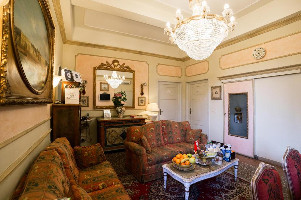 A seating area at Antica Residenza D'Azeglio Room&Breakfast di Charme