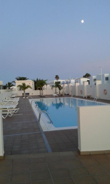 Het zwembad bij of vlak bij Riviera Park Apartamento 2A