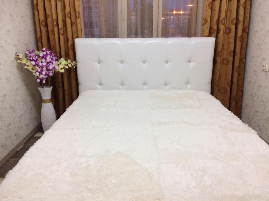 Кровать или кровати в номере Apartments Мира 2 Б