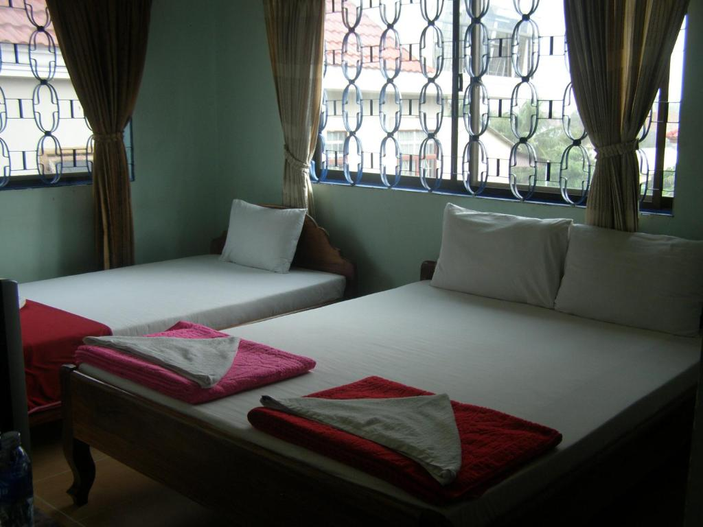 Ein Bett oder Betten in einem Zimmer der Unterkunft Bun Kao Guesthouse