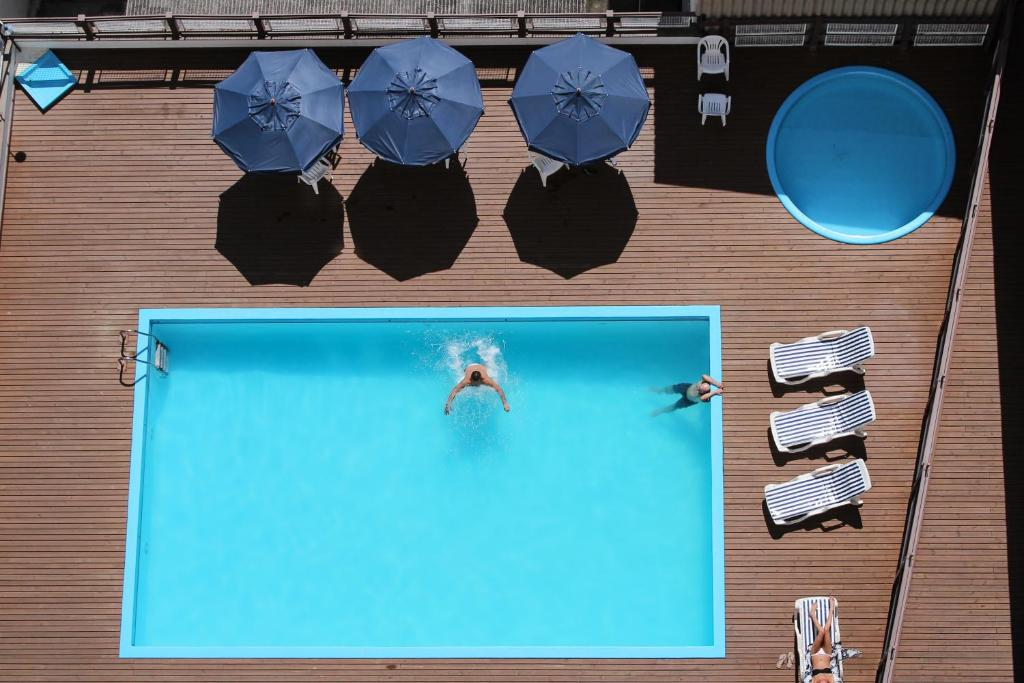 A view of the pool at Castelmar Hotel or nearby