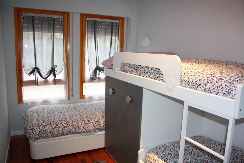 Cama o camas de una habitación en Vivienda Turística La Moleta