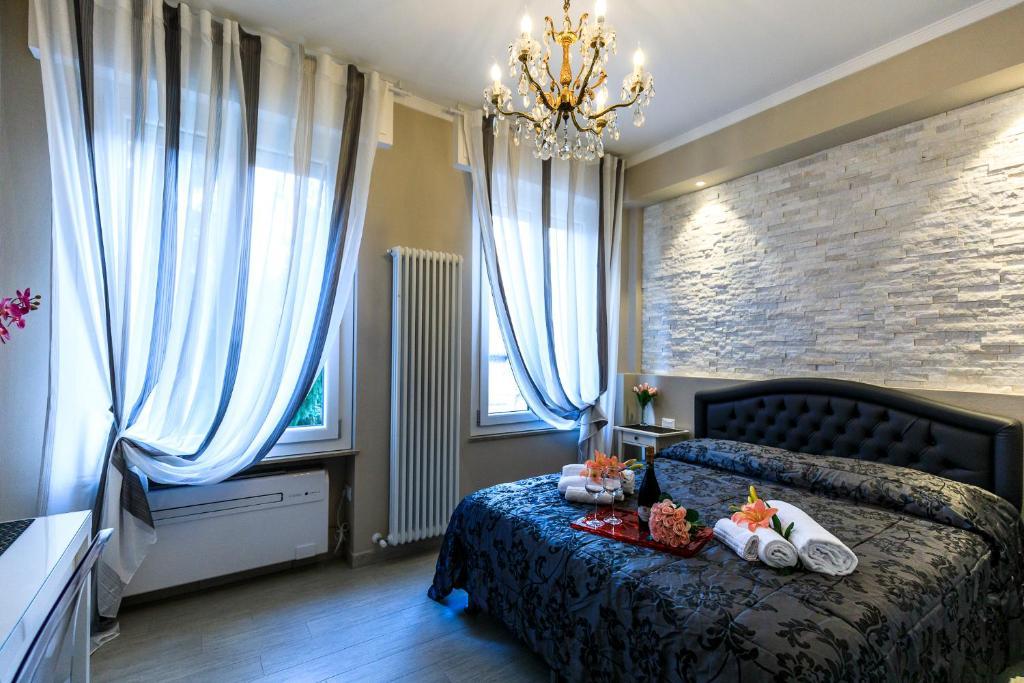 Un ou plusieurs lits dans un hébergement de l'établissement Maison degli Artisti