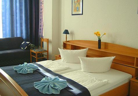Ein Bett oder Betten in einem Zimmer der Unterkunft City Pension Berlin