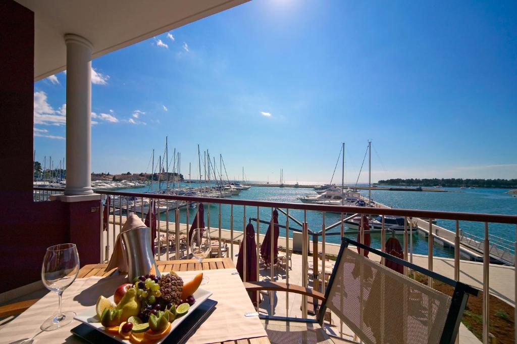 A balcony or terrace at Hotel Nautica by Stefano Cosattini - 2 Michelin star Executive Chef
