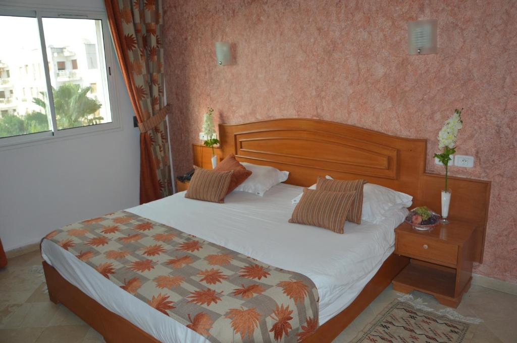 A bed or beds in a room at Hotel la princesse