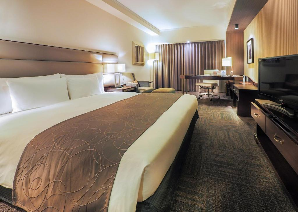 A bed or beds in a room at Ibis Styles Sapporo