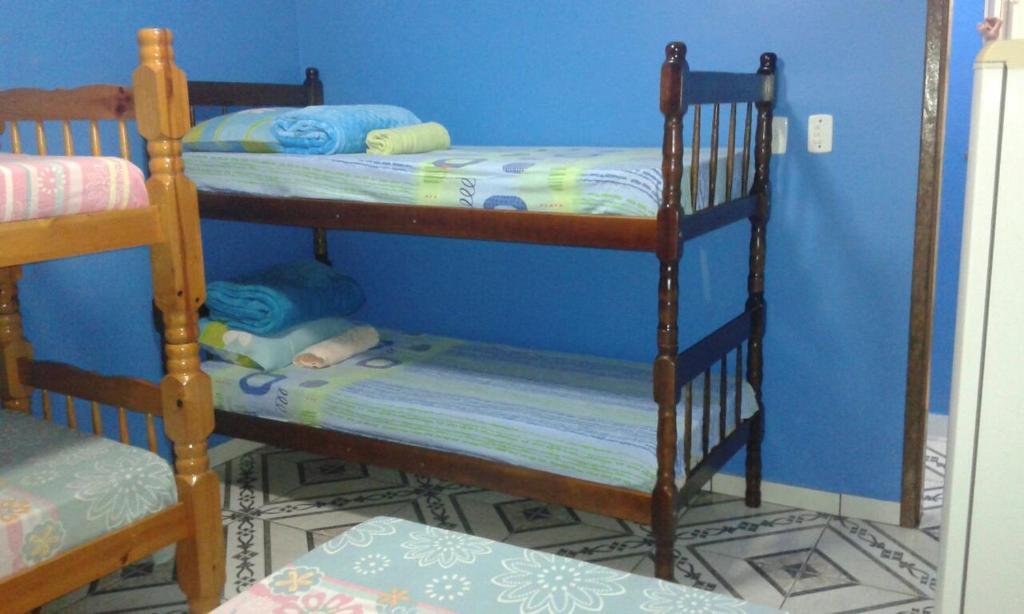 A bunk bed or bunk beds in a room at Pousada Do Pedrão