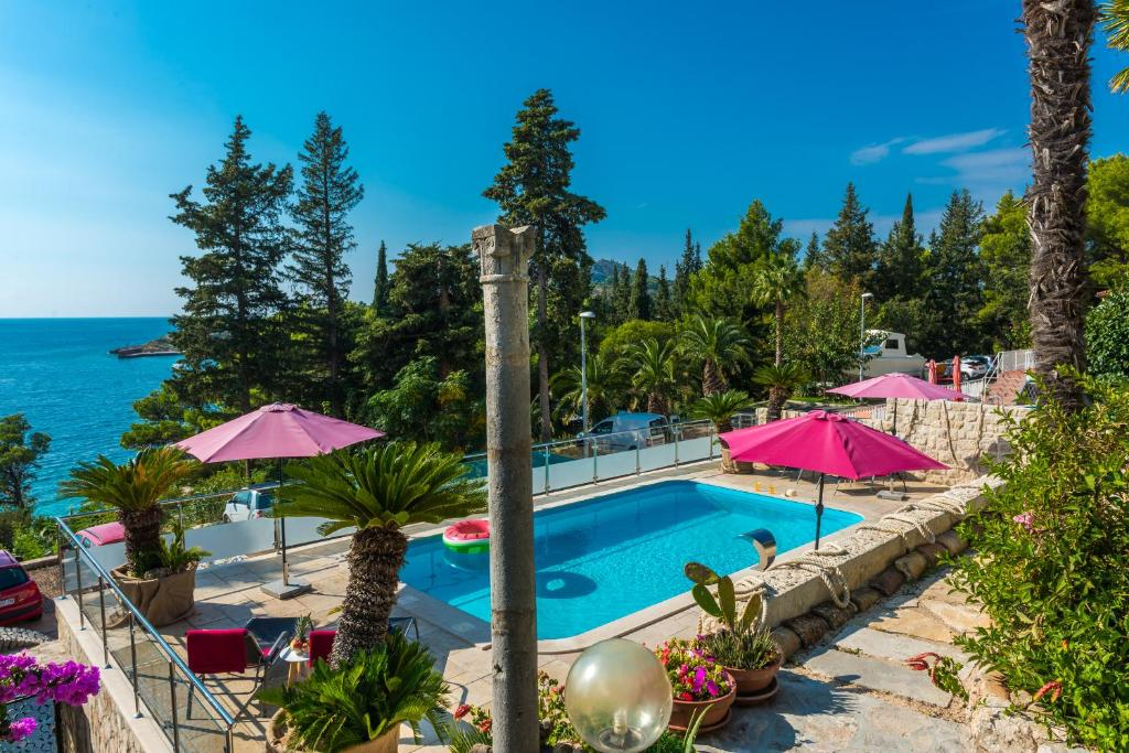 A view of the pool at Villa Carmen Rooms & Apartments or nearby