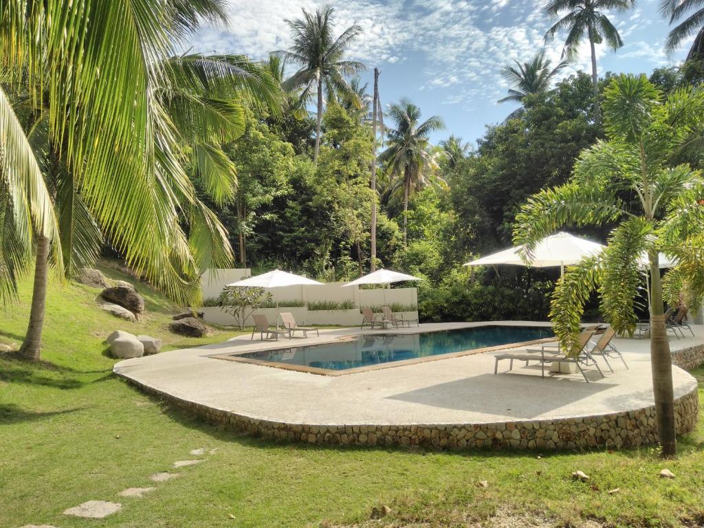 Het zwembad bij of vlak bij Woodlawn Villas Resort