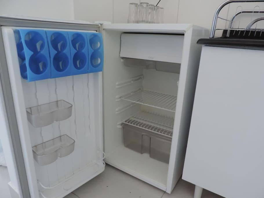 A kitchen or kitchenette at Meu Apê Maringá - UEM - Perto de tudo!
