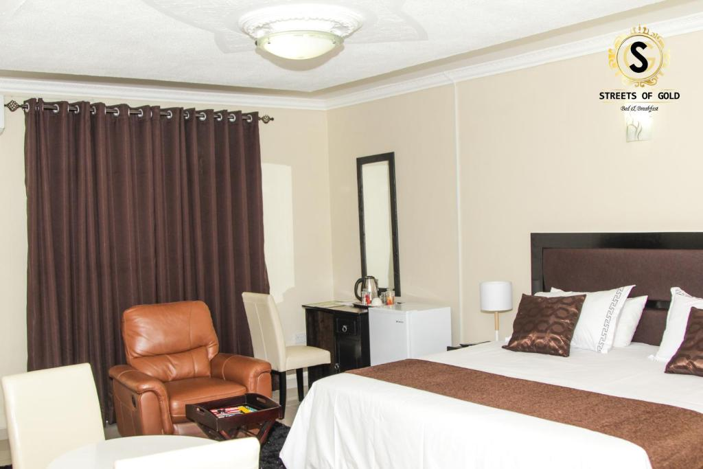 A bed or beds in a room at Streets of Gold Guest House
