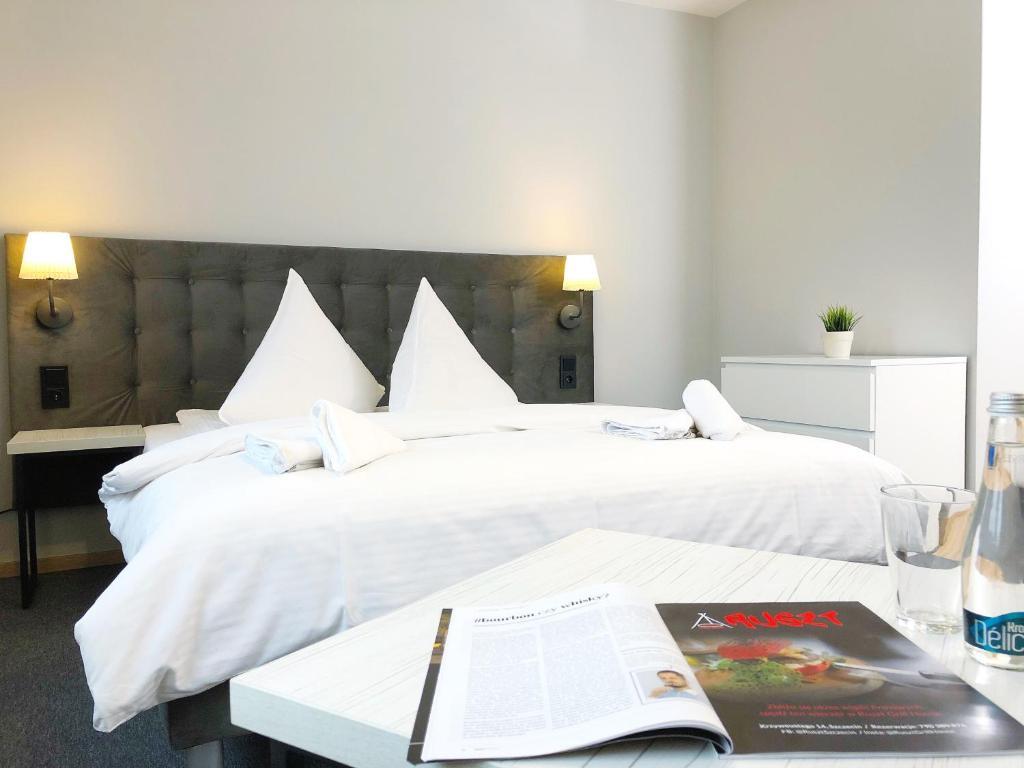 Łóżko lub łóżka w pokoju w obiekcie Residence Aparthotel