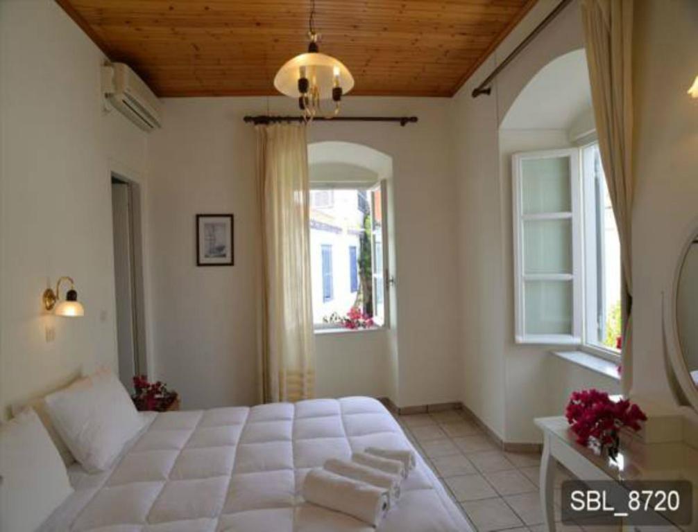 Ένα ή περισσότερα κρεβάτια σε δωμάτιο στο Areti