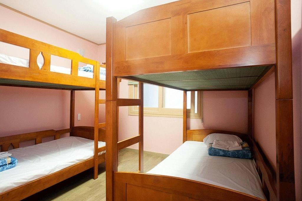 A bunk bed or bunk beds in a room at You&I Guesthouse