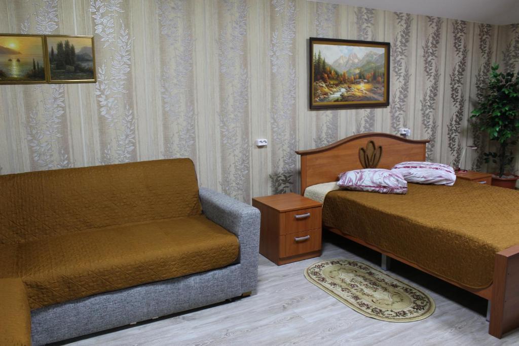 Кровать или кровати в номере Гостиница 12 Месяцев