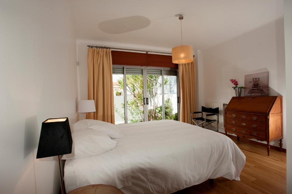 A bed or beds in a room at Casa Do Limoeiro