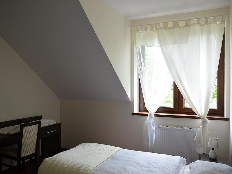 Łóżko lub łóżka w pokoju w obiekcie Hotel Cynamon