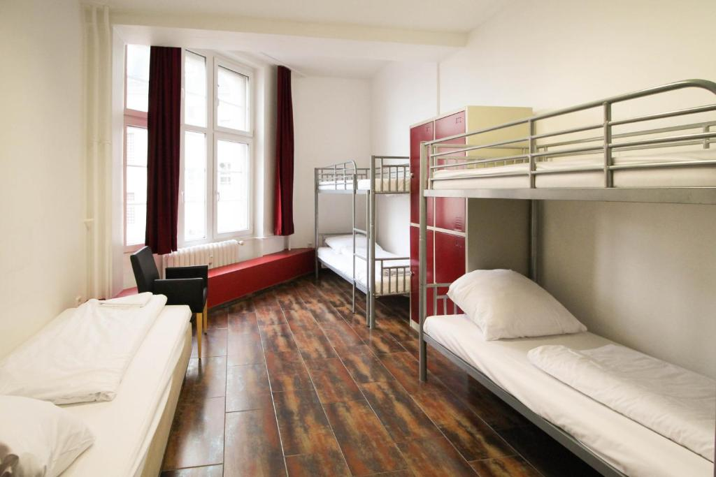 A bunk bed or bunk beds in a room at Metropol Hostel Berlin