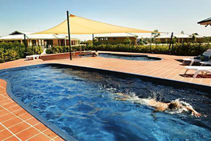 The swimming pool at or near Potters Apartments