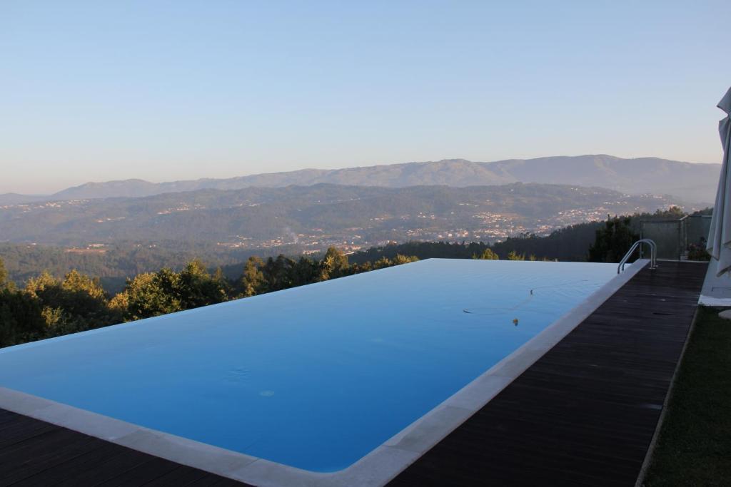 The swimming pool at or near Paço da Torre de Figueiredo das Donas