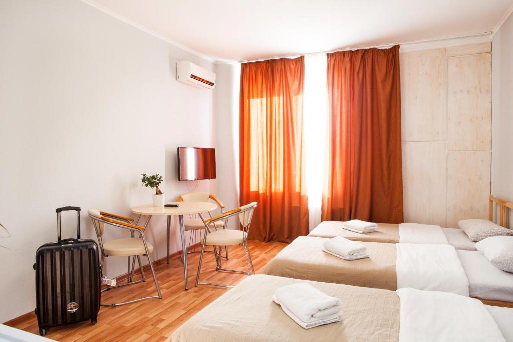 Кровать или кровати в номере Red 13 Center