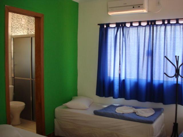 Cama ou camas em um quarto em Pousada do Ze Louquinho