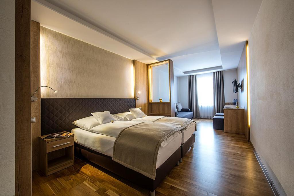 A bed or beds in a room at Penzión Berg