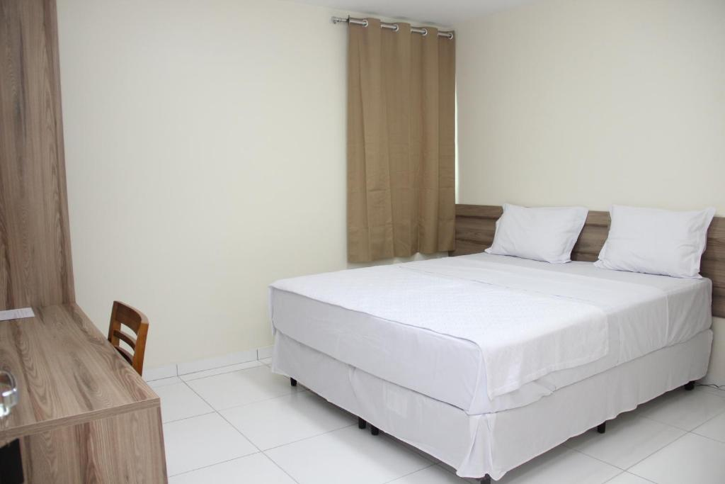 A bed or beds in a room at Hotel Executive
