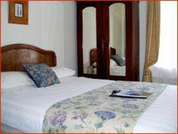 A bed or beds in a room at Crescent Guest House