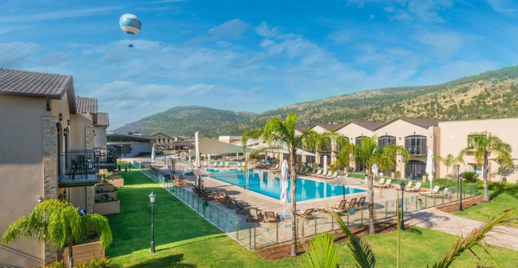 The swimming pool at or near Galilion Hotel