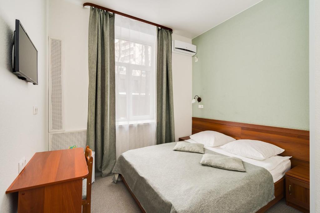 Кровать или кровати в номере Lefort Мини-отель