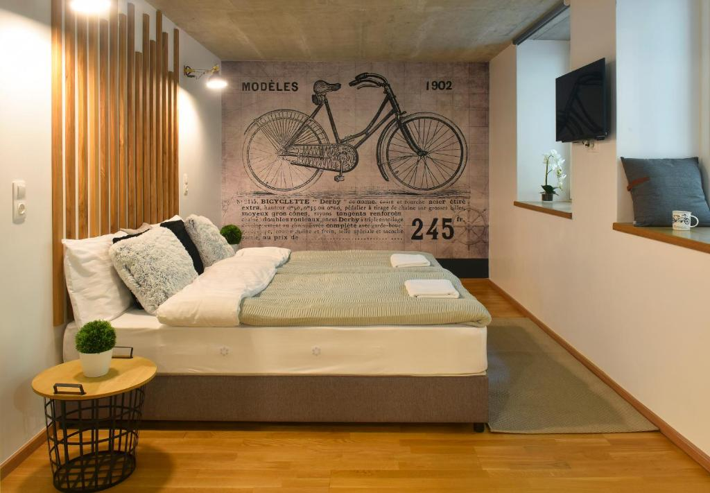 A bed or beds in a room at Walk Inn Váci 78