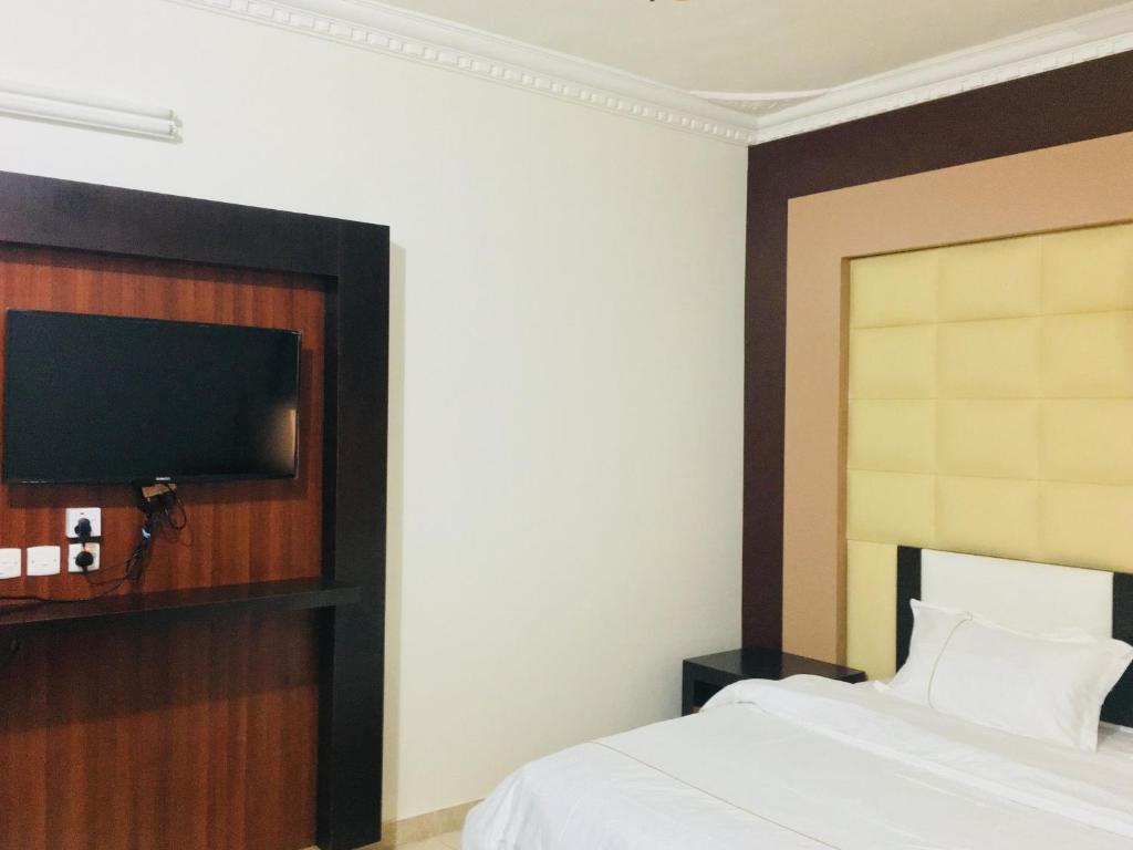 Cama ou camas em um quarto em Kasr Dama Furnished Apartments