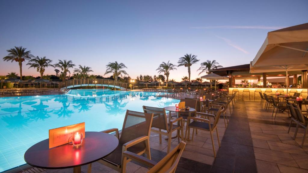The swimming pool at or near Horizon Beach Resort