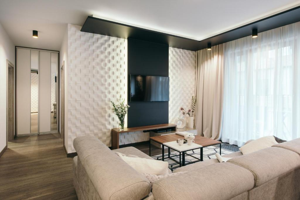 A television and/or entertainment centre at EXCLUSIVE Aparthotel