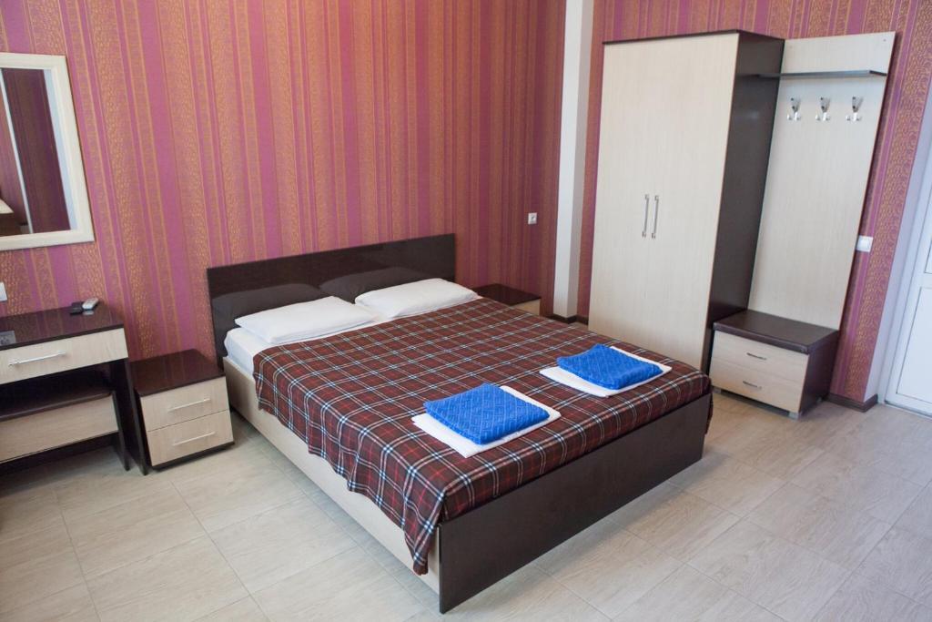 Кровать или кровати в номере Reskator Hotel