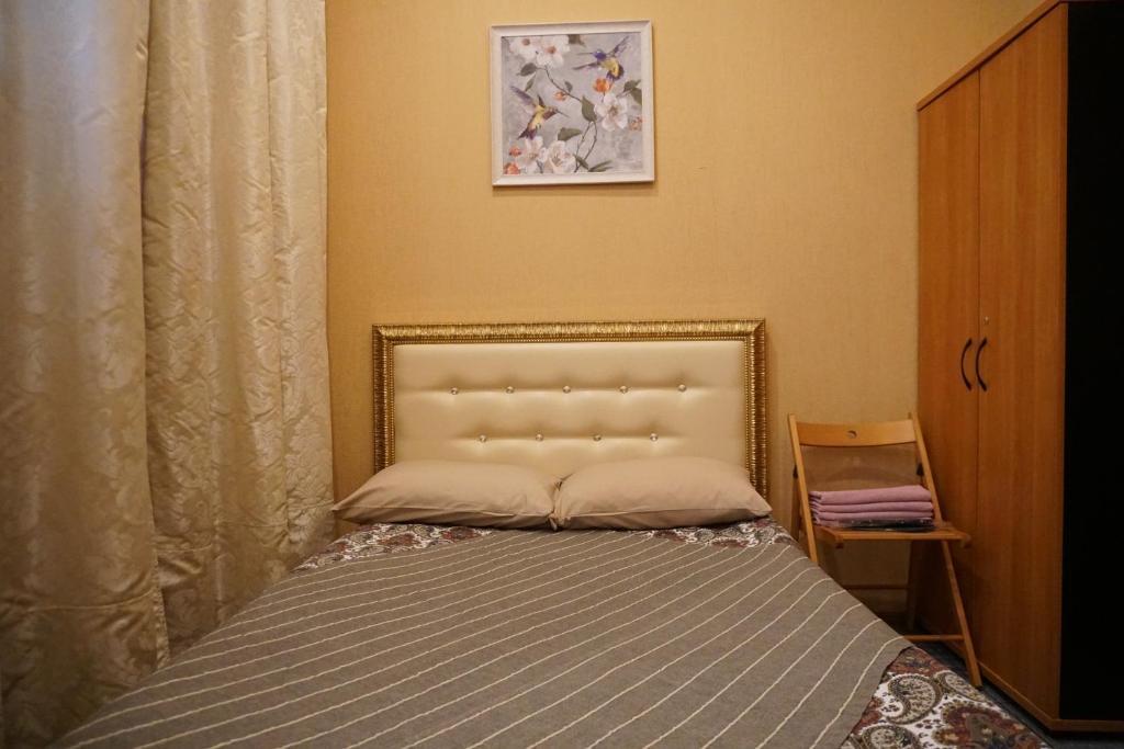 Кровать или кровати в номере Отель Александрия Капотня