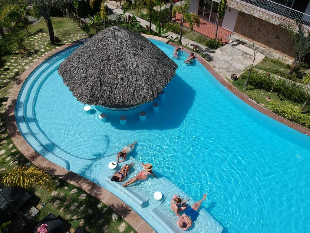 A view of the pool at Le Forest Resort or nearby