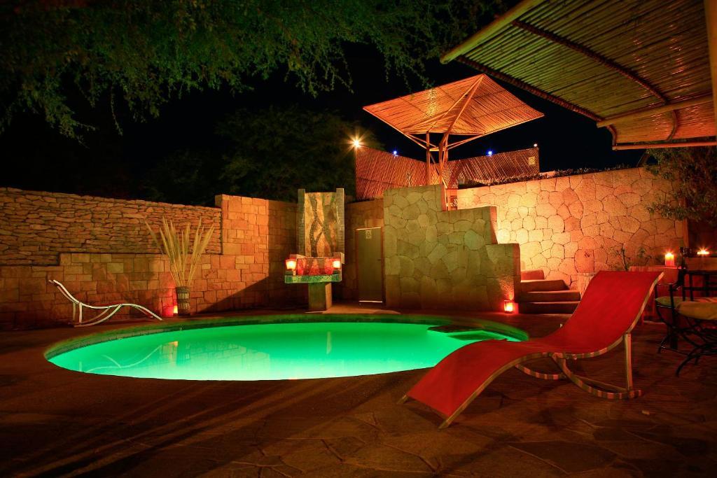 The swimming pool at or near Hotel Kimal