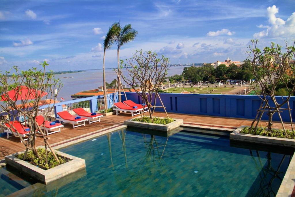 The swimming pool at or near The Frangipani Royal Palace Hotel