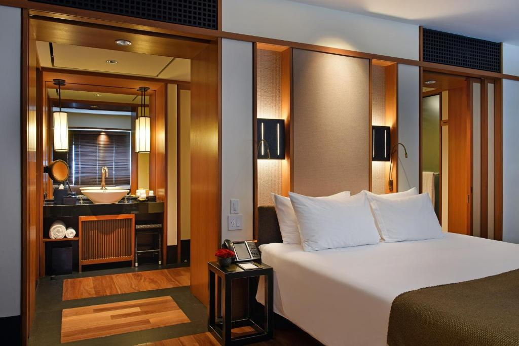 A bed or beds in a room at The Setai, Miami Beach