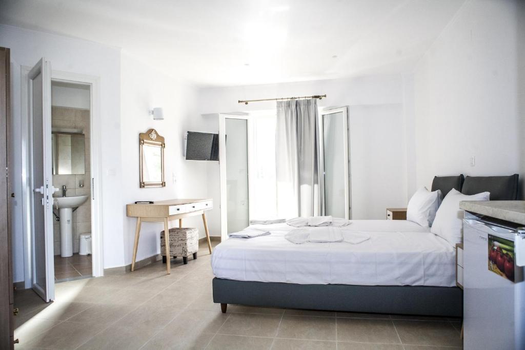 Ein Bett oder Betten in einem Zimmer der Unterkunft Athineon