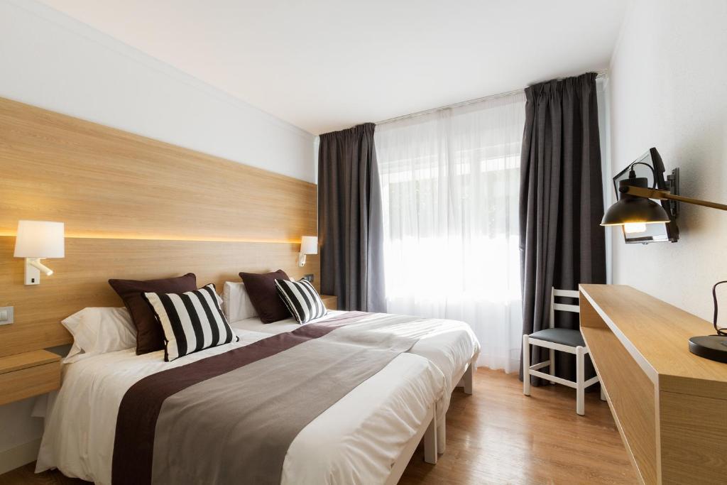 Łóżko lub łóżka w pokoju w obiekcie Duvabitat Apartments